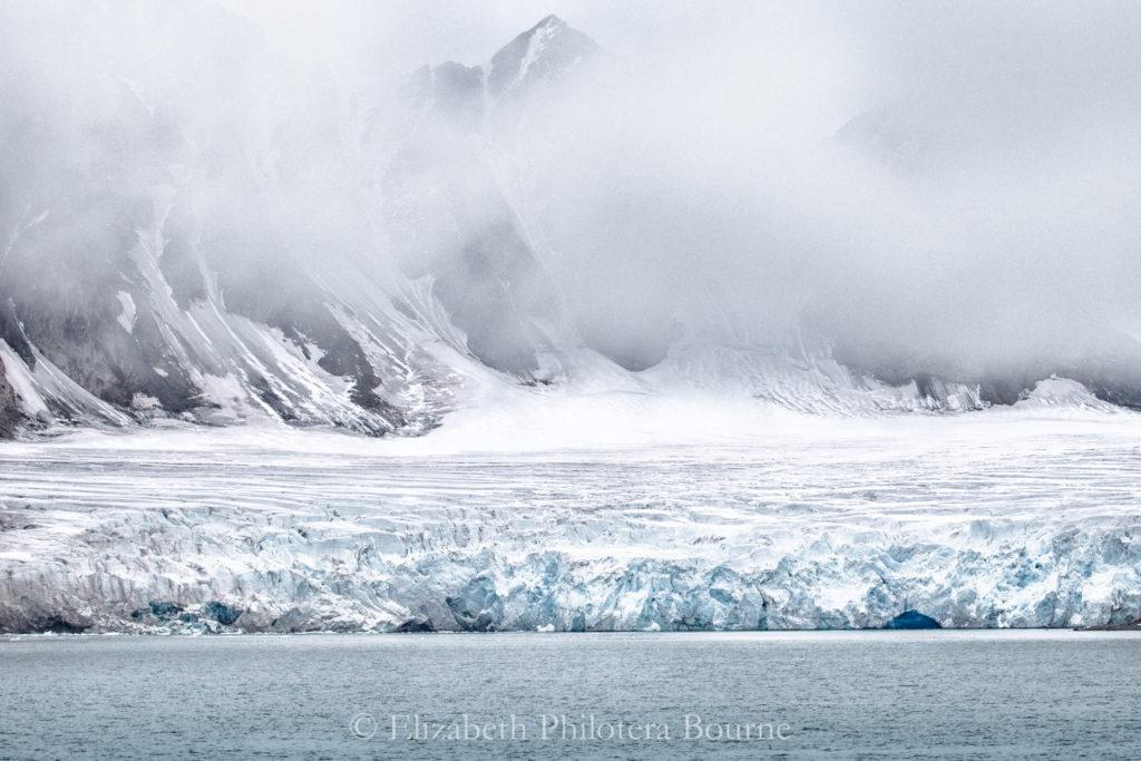 Glacier emerging from fog in Svalbard