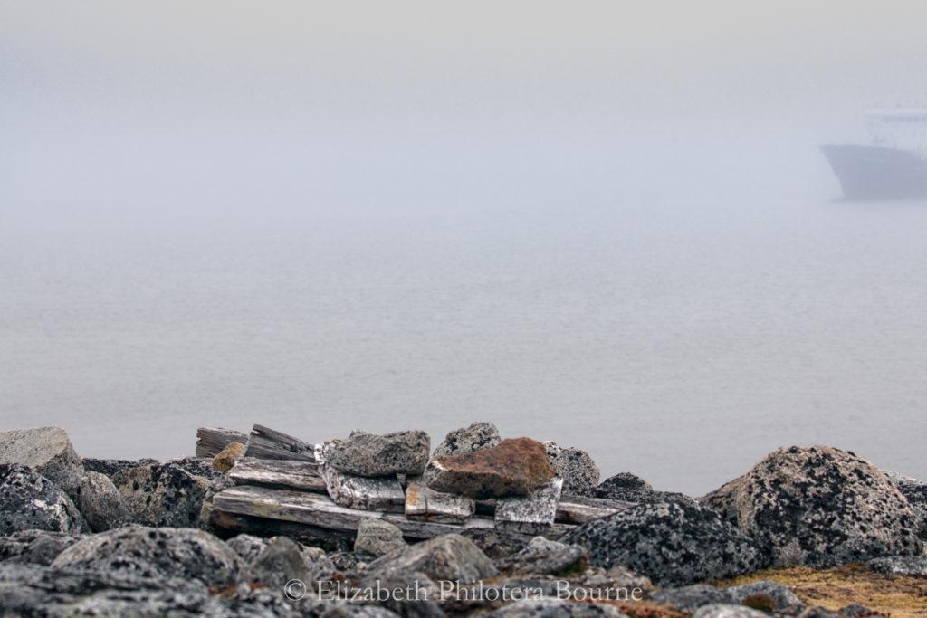 Grave of 17th century whaler in fog on Spitzbergen
