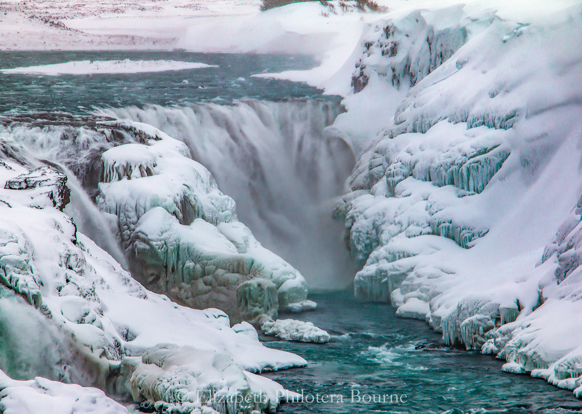 Frozen Gulfoss water fall surrounded by icicles and snow in Iceland on the Golden Circle
