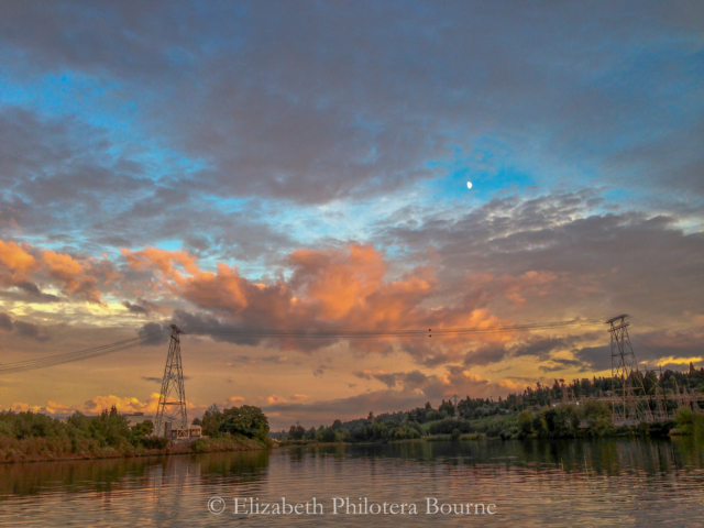 landscape of Duwamish river at sunset with high power lines
