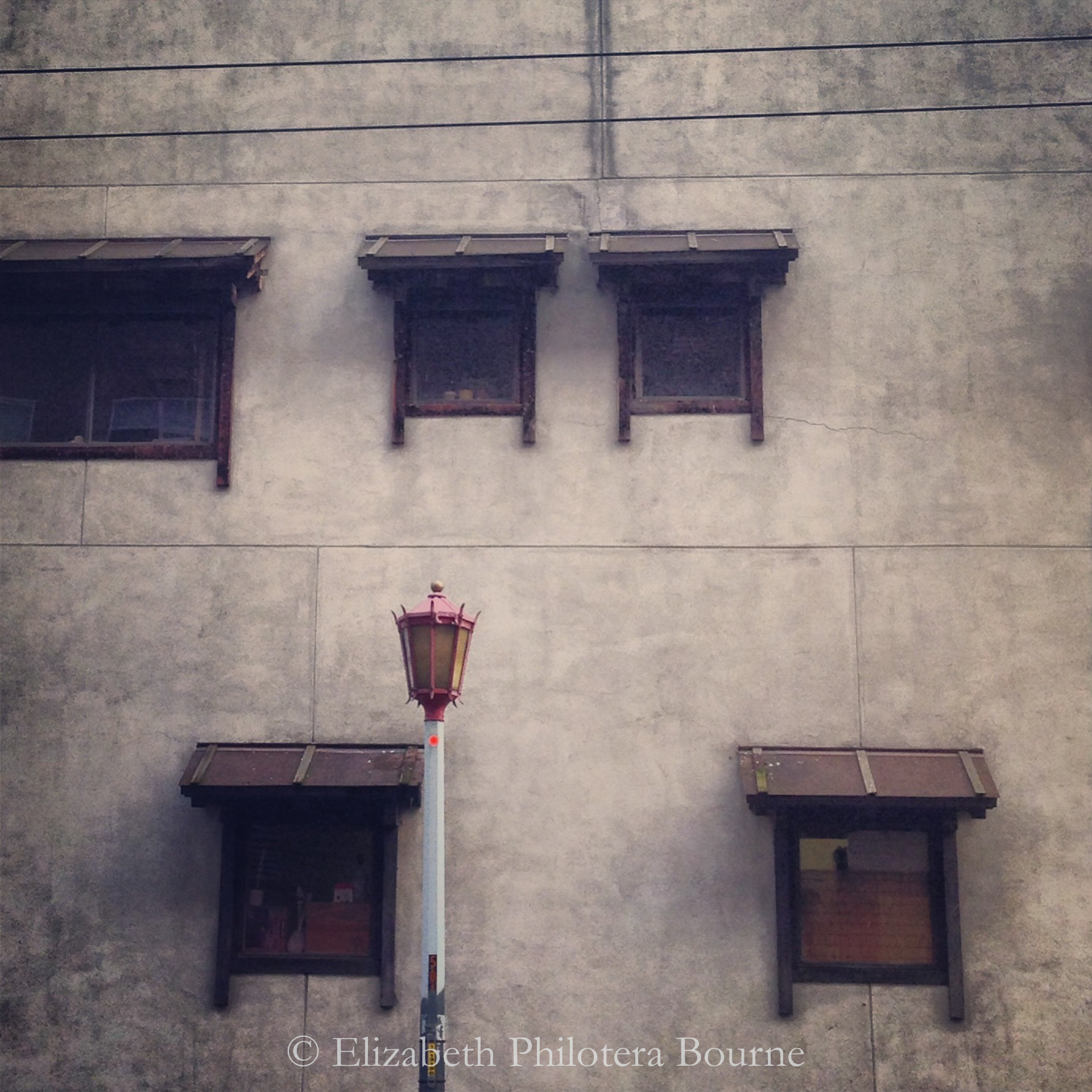 Five windows in wall with decorative Chinese light