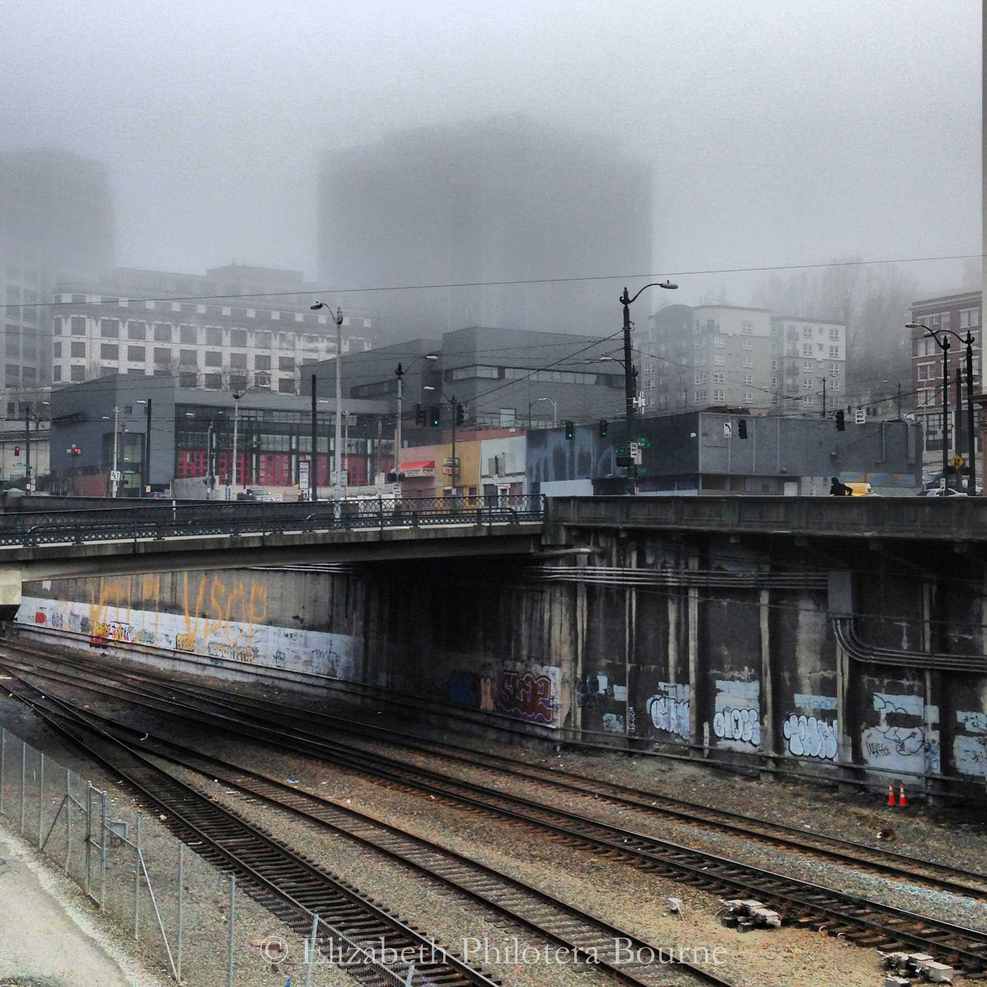 Seattle train tracks in downtown with graffitti and fog