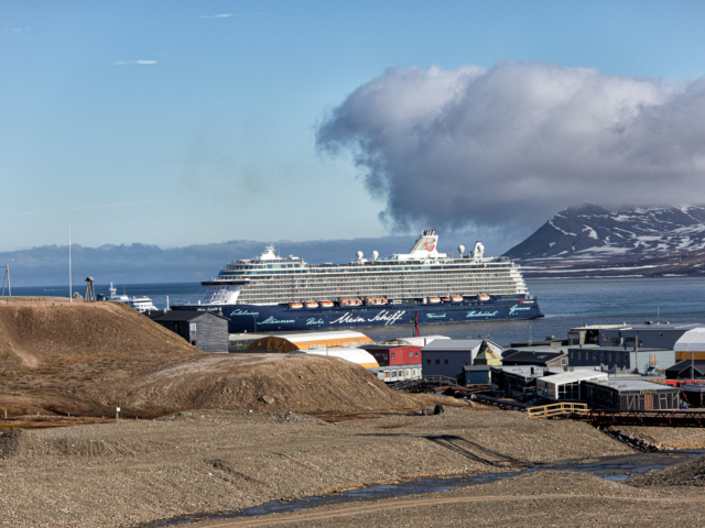 Mein Schiff 4 comes in to Port in Longyearbyen on a clear summer day