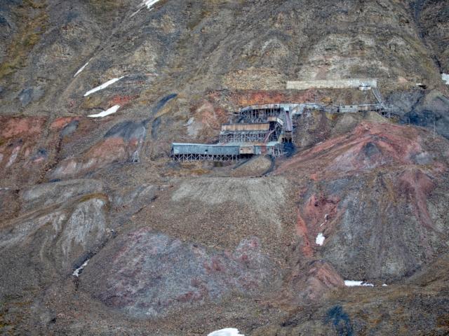 Abandoned mine 2b against orange brown and black hillside in Longyearbyen