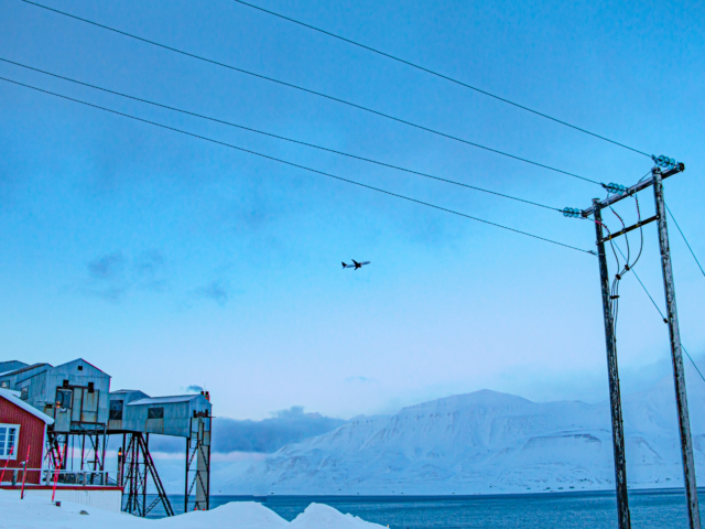 SAS jet flying out of Longyearbyen on a blue day in early spring