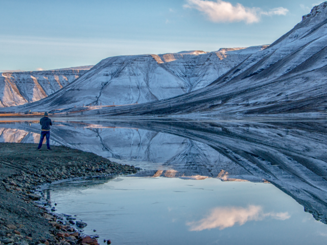 Isdammen, the reservoir of drinking water for Longyearbyen Svalbard perfetly reflects the surrounding mountains