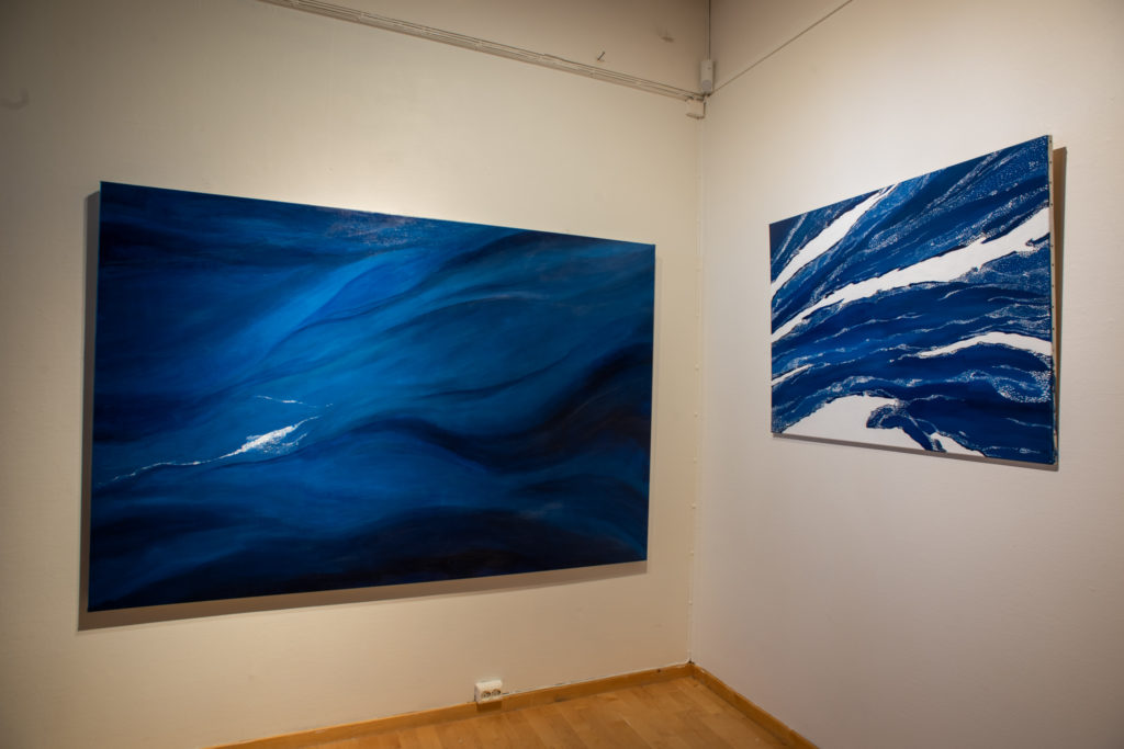 Two paintings of drift ice in blue color