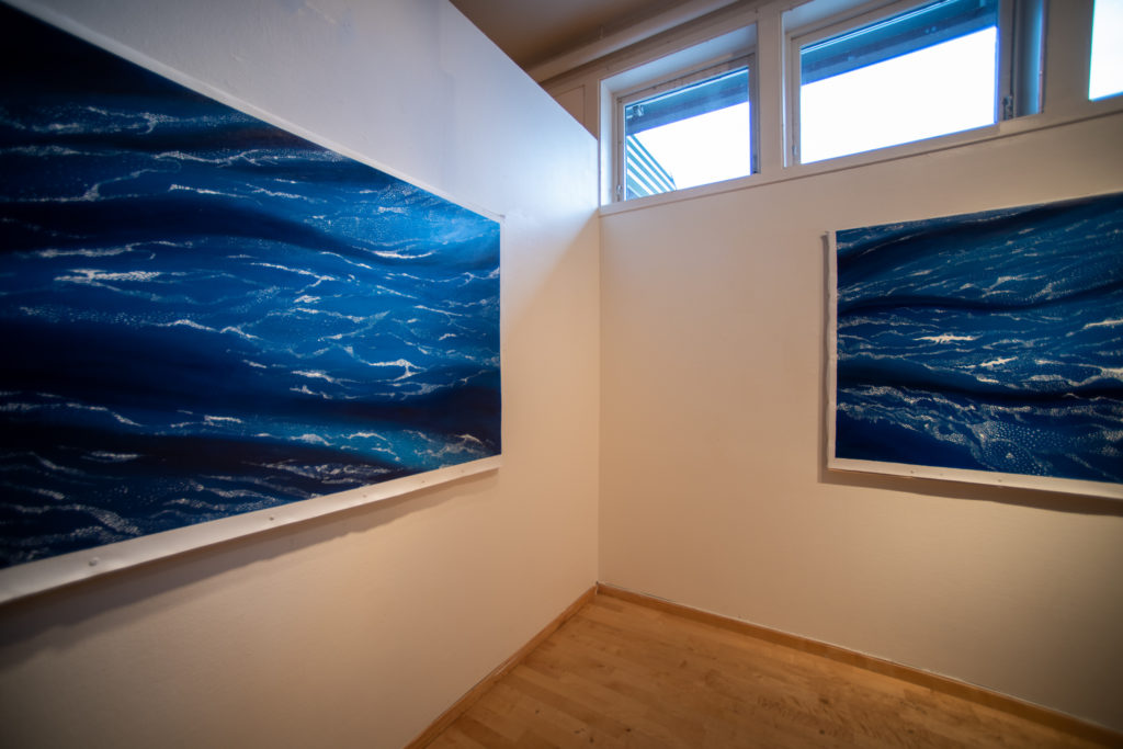 two blue drift ice paintings
